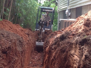 french drain and bamboo retainer wall trenching